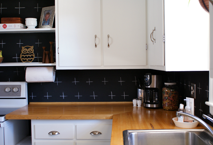 Budget kitchen update. Chalkboard paint back splash with plus signs. Butcher block counter tops